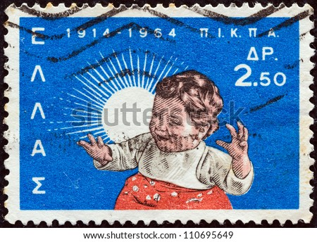 GREECE - CIRCA 1964: A stamp printed in Greece issued for the 50th anniversary of National Institution of Social Welfare (P.I.K.P.A.) shows a child, circa 1964.