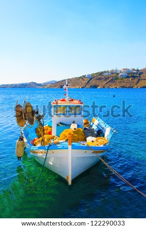 Greece, Colorful front side view of wooden fishing boat at Santorini Island Greece - stock photo