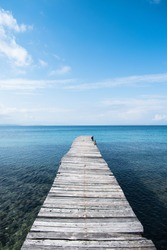 Greece - Corfu Island - Timber jetty projetcing on a calm Mediterranean Sea