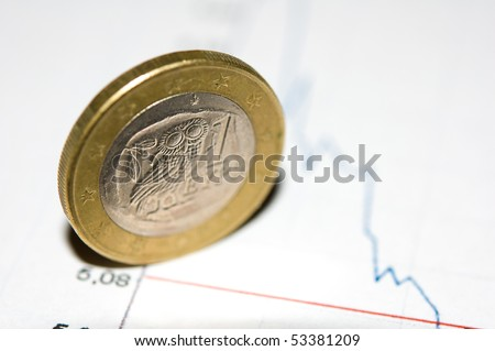 Greece euro coin on a crashing chart background