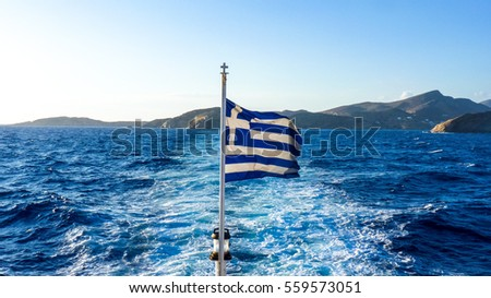 Greece flag and the Deep Blue of the Aegean Sea near Ios, Greek Islands, Greece