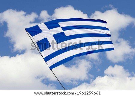 Greece flag isolated on sky background with clipping path. close up waving flag of Greece. flag symbols of Greece.