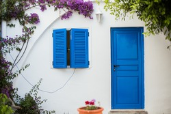 Greece. Greek houses with blue shutters and doors