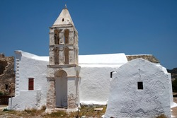 Greece, Kythira island. Church, hora, by the historic castle. Traditional old chapel with dramatic bell tower.  Clear blue sky provides copy space. Landscape aspect shot.