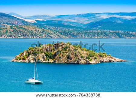 Greece,Peloponesse,Tolo town near Nafplion city. View of the sea with a small island and a    white catamaran  Stock fotó ©