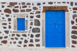 Greece Santorini ialnd in cyclades, traditional church in oia with wooden doors and wooden frames