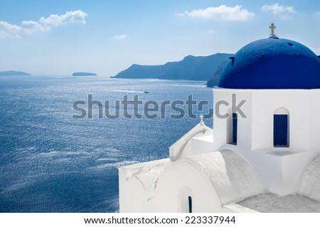 GREECE, SANTORINI- OCT 3: The greek church in the Oia village, sea view. October 3, 2014