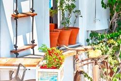 Greece Traveling Ideas. View of Greek Traditional Houses of Oia or Ia at Santorini Island in Greece. With Old Rusty Bicycle in Background. Horizontal image