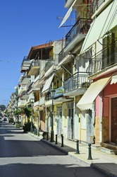 Greece, Zakynthos, street and different homes with balconies