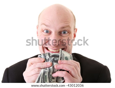greed, businessman with money. man holding dollars in display of avarice isolated on white.
