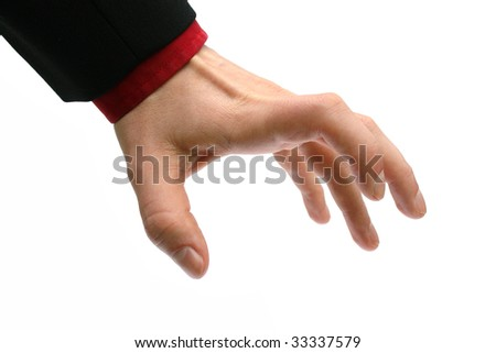 greedy hand of a business man reaching for something