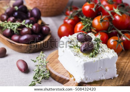 Greek cheese feta with thyme and olives, selective focus