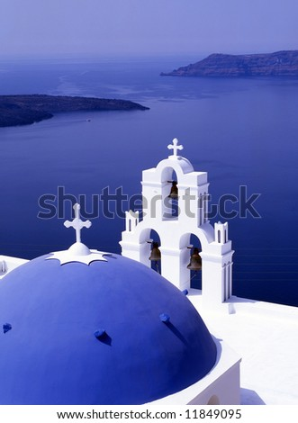 Greek church overlooking the bay of Santorini, Greece - stock photo
