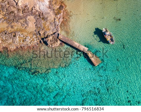 Greek Colorful top down view of fishing boat. Stavros bay of Chania, Crete island of Greece. #796516834