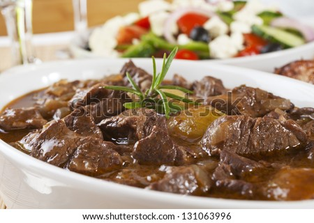 Greek Dish Stifado, Made With Lamb And Served With Greek Salad. Can Also Be Made With Beef Or Game.
