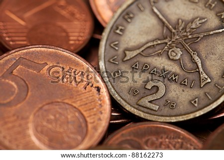 Greek drachmas (two) and euro coins (macro shot using shallow DOF)