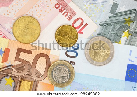 Greek Euro coin and banknotes as symbol for the financial problems of that country