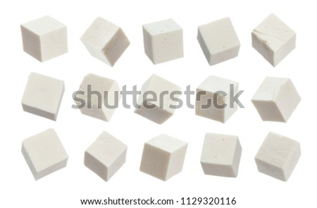Greek feta cubes. Diced soft cheese isolated on white background