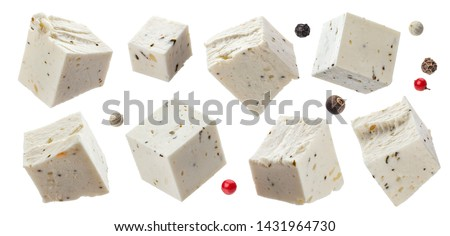 Greek feta cubes with herbs and spices, diced soft cheese isolated on white background with clipping path, collection