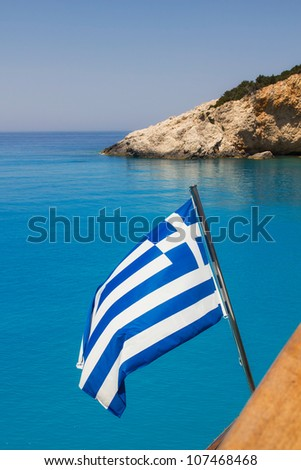 Greek flag on a cruise ship with the famous Porto Katsiki beach in the background
