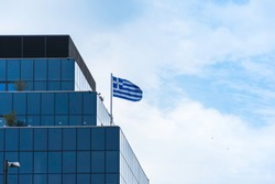 Greek flag on a modern building in Athens, Greece