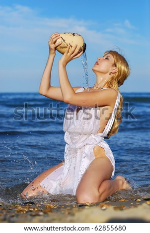 Greek girl pours water from a pitcher