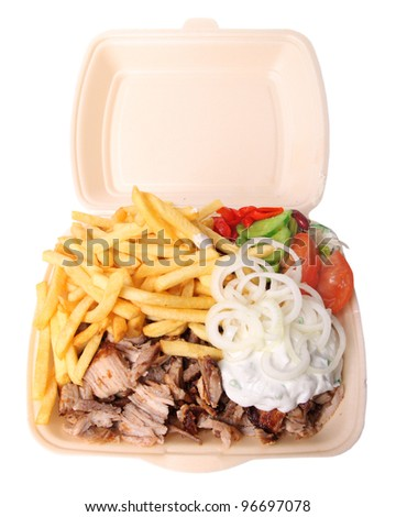 greek gyros plate with fries salas and tzaziki isolated on white