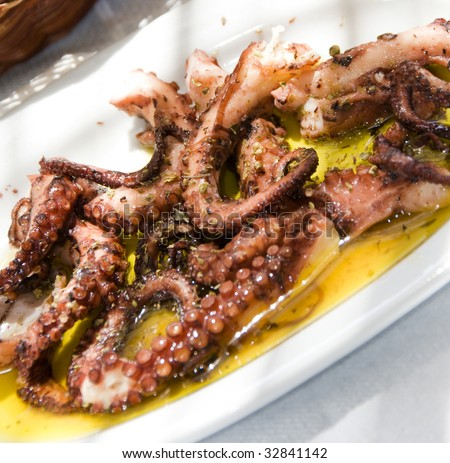 greek island taverna restaurant specialty of marinated grilled octopus  as photographed in antiparos cyclades islands greece