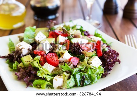 Greek Mediterranean salad with feta cheese, tomatoes and peppers. Mediterranean salad. Mediterranean cuisine. Greek cuisine.