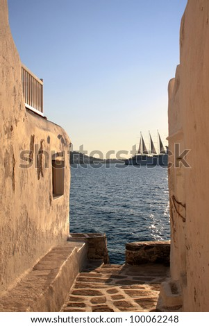 Greek Mykonos island with cruise ship at sunset