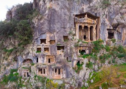 Greek rock hewn tombs on mountain side at ancient Telmessos in Lycia, currently in district of Fethiye in Mugla Province, Turkey