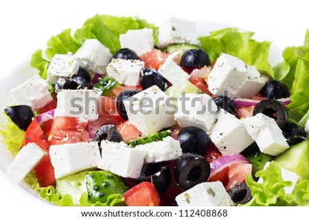greek salad in plate closeup isolated on white background