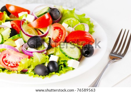 Greek salad in the white plate closeup shot