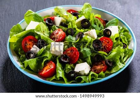 Greek salad on stone background