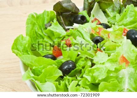 Greek salad style on wood background