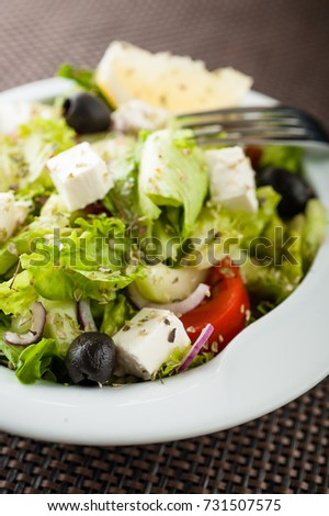 Greek salad with Feta cheese, Aisberg salad, black olives, onions, cucumber and other Imagine de stoc ©