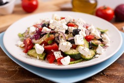 Greek salad with feta cheese, green peppers, black olives, tomatoes. Ideas for summer, light and fast lunch. Nutritious and complete food.
