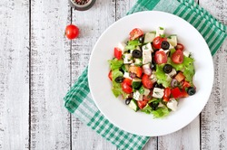 Greek salad  with fresh vegetables, feta cheese and black olives. Top view