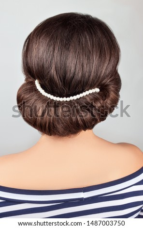 greek style hairdo with string of pearls. Hairstyle for long hair
