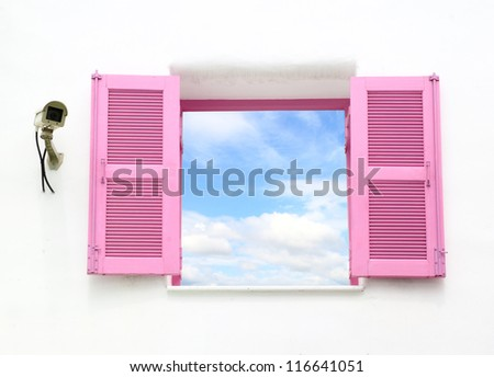 Greek style windows with cctv and blue sky view