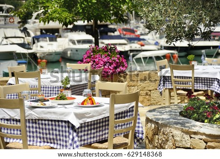 greek tavern table with sea view
