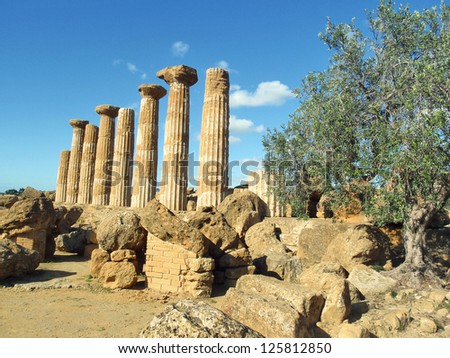greek temple with olive tree - stock photo