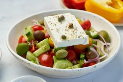 Greek village salad horiatiki with feta cheese and vegetables, vegeterian mediterranean food, low calories keto dieting meal, side view, close up