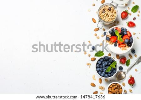 Greek yogurt granola with fresh berries on white table, top view, copy space. Healthy food, snack or breakfast. #1478417636