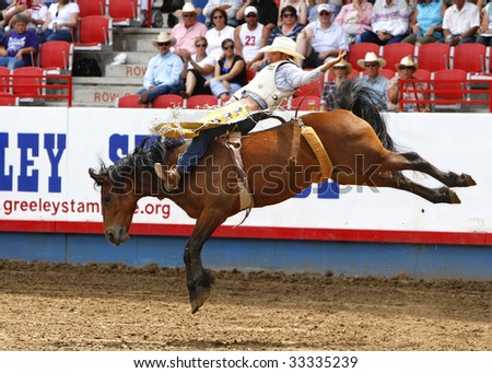 GREELEY, CO - JULY 4:  Bobby Mote wins the bareback title at the Greeley Stampede, the worlds largest Fourth of July rodeo, on July 04, 2009  in Greeley, CO..  Mote is a 2-time PRCA world champion. - stock photo