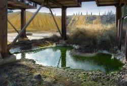 Green acidic pool of toxic waste near abandoned Kokkinogia copper mine in Mitsero, Cyprus
