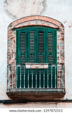 Green aged vintage building balcony. Classic european architecture. Village tourism