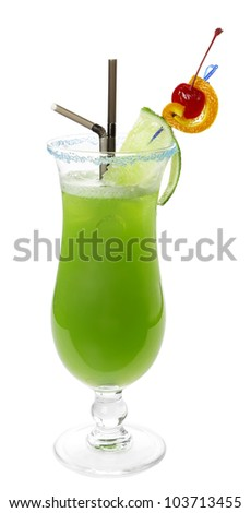 Green alcoholic cocktail with two tubes, lime, orange and red cherry on a skewer. Blue sugar on the edge of the glass