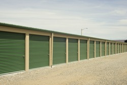 Green and beige outdoor self storage units.