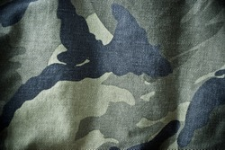 Green and black camouflage clothing background or texture